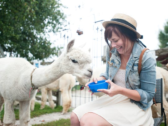 File - Caitlyn Teetzen, of Sheboygan, has fun feeding
