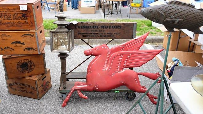 An antique Mobil Oil pegasus sign at the Nashville Flea Market.