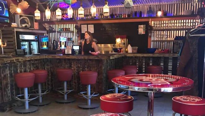 An inside dining area at Shark Bar & Grill