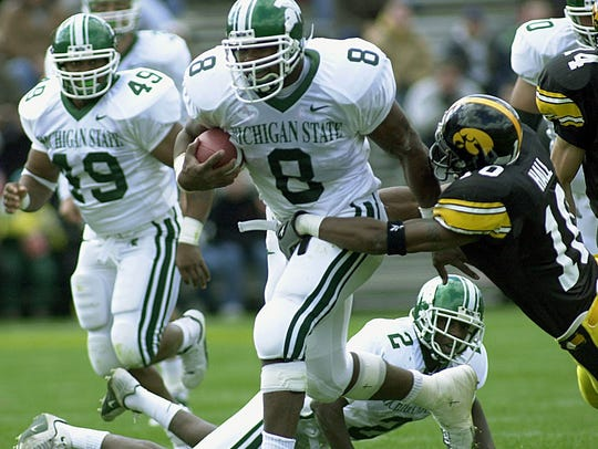 MSU's T.J. Duckett ran through and by and sometimes