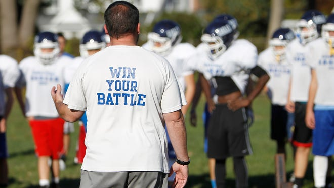 Dobbs Ferry football head coach Jim Moran talks to players during practice on Tuesday, Oct. 20, 2015.