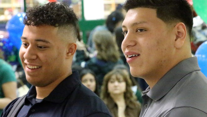"""UTEP football recruits Josh Ortega, left, and Robert """"Bobby"""" DeHaro speak before the start of their signing ceremony Wednesday at Montwood High School. The pair signed to play football at UTEP."""