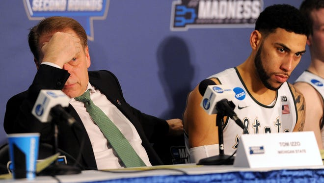 Michigan State Head coach Tom Izzo listens to a reporter's question during the post game press conference after Middle Tennessee upset the Spartans 90-81 Friday, in St. Louis. Denzel Valentine is at his side.