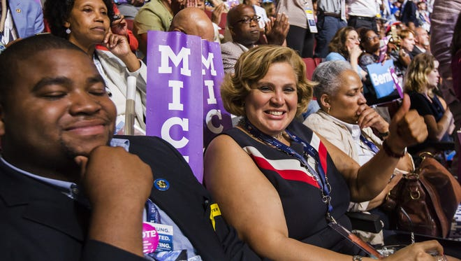 Wilmington City Councilwoman Maria Cabrera sits with the Delaware delegation at the Democratic National Convention in the Wells Fargo Center in Philadelphia on Monday. Delegates had to endure heavy traffic and lengthy lines.