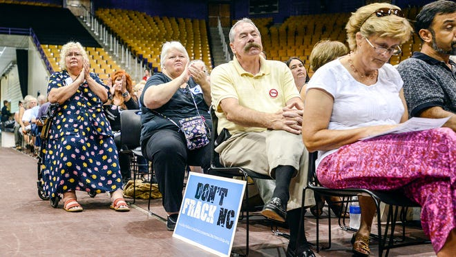 People cheer a speaker during a public hearing held by the Mining and Energy Commission about the proposed rules for hydraulic fracturing, or fracking, in Western North Carolina at the Ramsey Center at Western Carolina University in Cullowhee Sept. 12. About 600 people attended.
