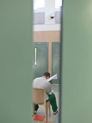 A teen works on schoolwork in a detention pod at the Lincoln Village Youth Development Center in Hardin County.