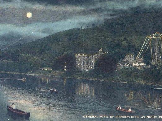 This vintage postcard shows a night view of Rorick's Glen park in what is now the Town of Elmira along the Chemung River.