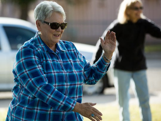 Patti Wiles, one of the six tai chi students attending Steve Barowsky's class in the park next to the Mesilla Park Community Center, Thursday, Nov. 10, 2016.