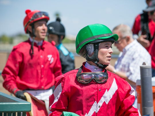 Jockey Erin Walker leaves the track after finishing