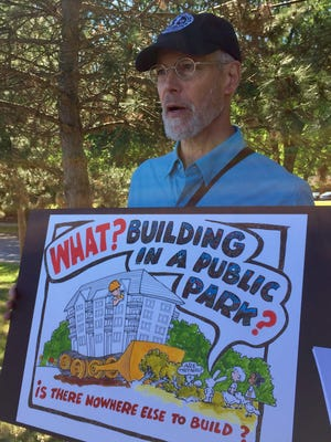 Peter Debes, chairman of the local Sierra Club, speaks out against senior apartments proposed within Cobbs Hill Park.