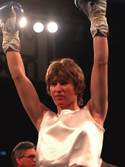 Deirdre Gogarty, shown here raising her arms in victory after defeating Deborah Stroman back in 1996, was inducted into the Women's International Boxing Hall of Fame in 2015.