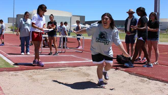 Kassy Silva, an Oñate High School student, participates in the standing long jump during the Special Olympics Project UNIFY at Centennial High School on Wednesday, May 17, 2017.