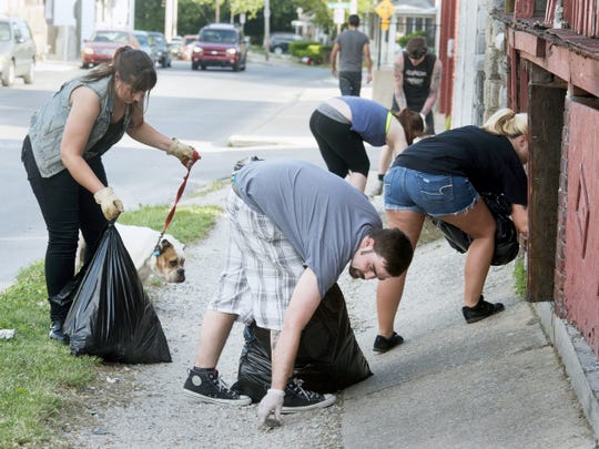 """From the left, Ashlee Jones with her dog, Chauncey; Josh Hoke; Catie Myers; Mel Goldenbaum and, in rear, Steve Klinedinst during a Punks for Positivity cleanup in York last weekend. The """"punks"""" promote their cleanups primarily on social media. The group's Facebook page was established in April and had 268 likes as of May 28."""