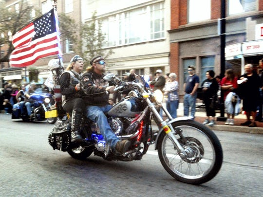 Hundreds of motorcyclists join in the York Bike Night parade along Market St. Friday, Sept. 19, 2014. York Bike Night, with attractions in and around Continental Square, is sponsored by Harley-Davidson Motor Co. and The City of York. Bill Kalina - bkalina@yorkdispatch.com