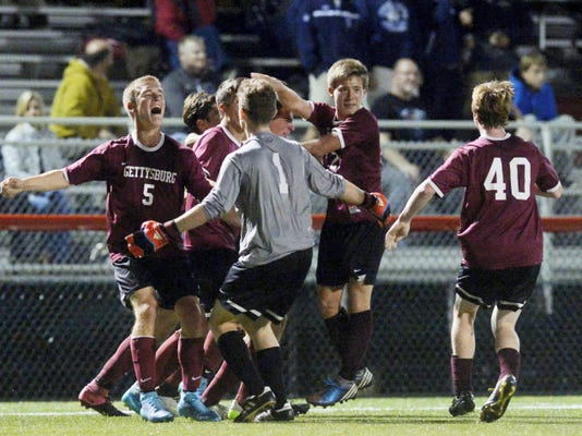 Gettysburg players celebrate after winning the YAIAA boys' soccer tournament championship game Thursday at Susquehannock. Gettysburg defeated Central York, 1-0.