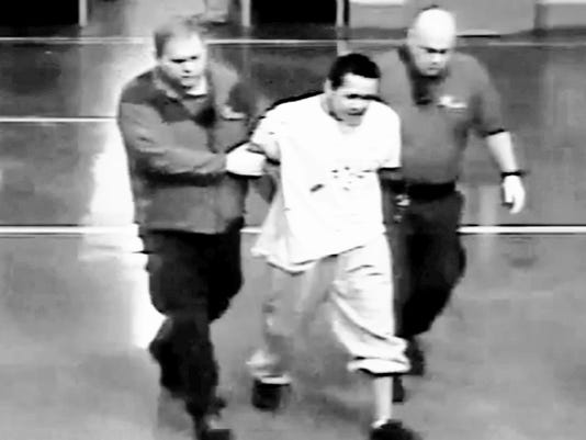 A still from a surveillance video shows an inmate being taken into custody after a fight Sunday morning at the San Juan County Adult Detention Center in Farmington.