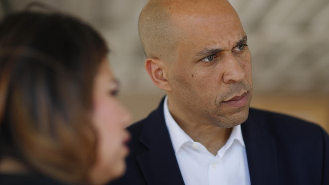 Democratic presidential candidate Sen. Cory Booker, right, speaks with Astrid Silva, left, and others after a round table with Dreamers and immigrant activists, Saturday, April 20, 2019, in Las Vegas.
