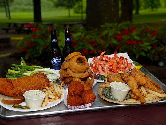 Fish plate; frog legs (just an order will be fine); combination salad; an order of scallions; peel and eat shrimp; and a beer at Mike Linnings._(By Bill Luster, The Courier-Journal)_July 8, 2011