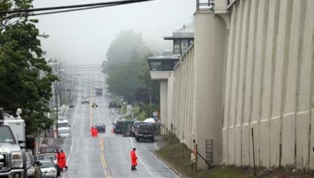 A guard stands on the wall at Clinton Correctional Facility on Monday, June 8, 2015, in Dannemora, N.Y. Two murderers who escaped from the prison by cutting through steel walls and pipes remain on the loose Monday as authorities investigate how the inmates obtained the power tools used in the breakout.