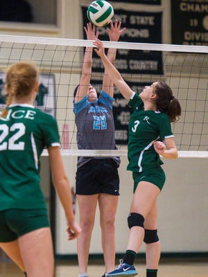 Rice Memorial's Mercy Beaudoin, right, goes up against South Burlington's Holly Wickens in South Burlington on Thursday, October 27, 2016.