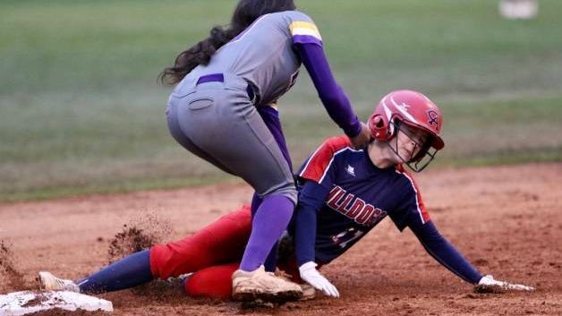 Chloe Carter (17), tagged out by Tashiya Lyles on a third-inning stolen base attempt, doubled home a pair of runs in her next at-bat Friday night as Columbia Academy remained unbeaten with a 4-0 win over visiting Columbia Central.