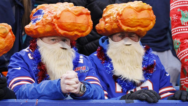 Buffalo Bills fans wear chicken wing hats during the second half of a game against the Miami Dolphins on Dec. Dec. 24, 2016.