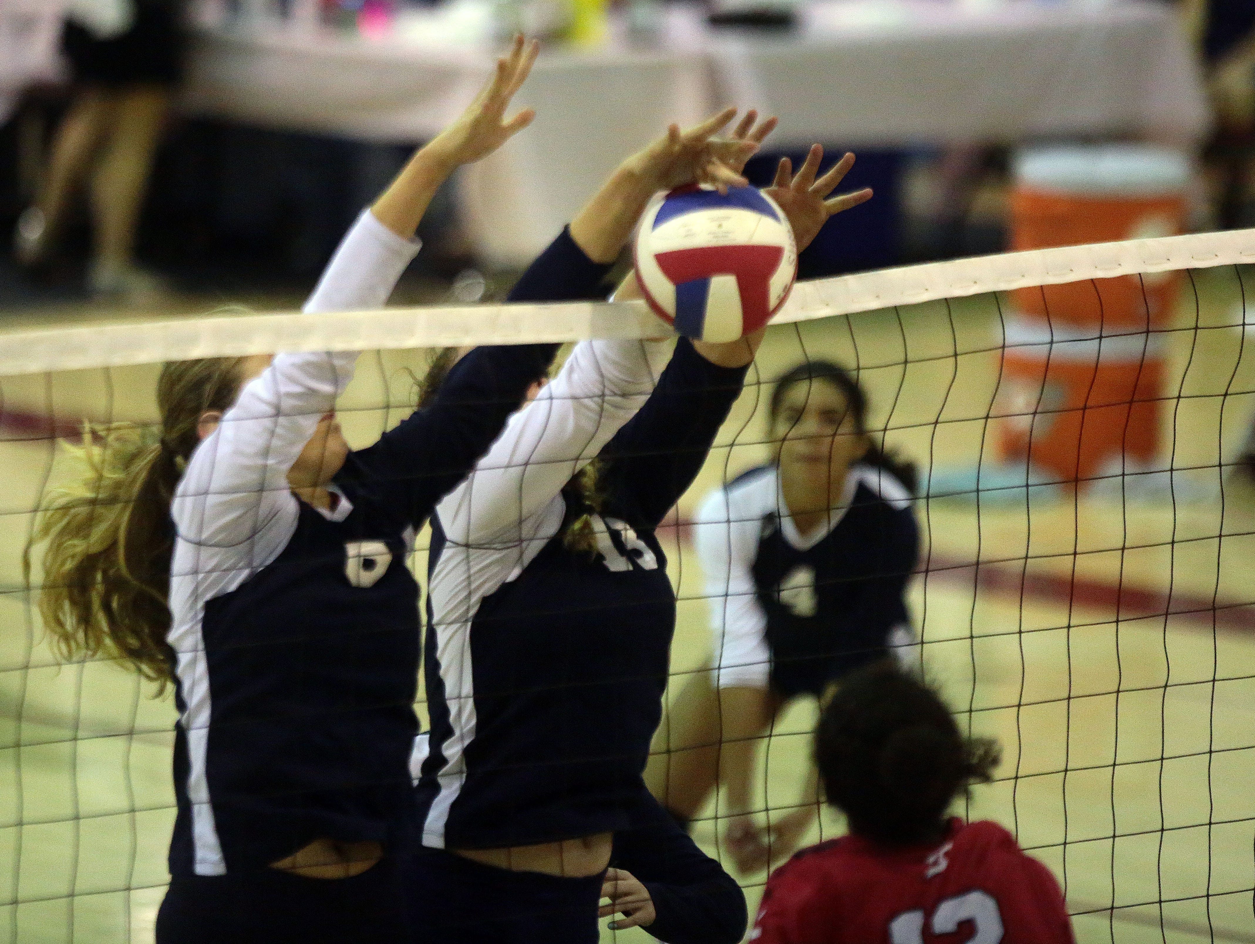 La Quinta's Lexi Christmas and Camryne Sommaripa blocks a spike by Palm Springs' Maribel Wright on Thursday in La Quinta. La Quinta won the match 3 sets to 1.