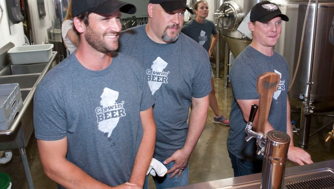 NJ Secretary of Agriculture Douglas Fisher toured Screaming' Hill Brewery in Cream Ridge , NJs first on farm brewery. Brewery co-owners l-r Brett Bullock, Patrick Jones and Ryan Cole —August 25, 2015-Cream Ridge, NJ.-Staff photographer/Bob Bielk/Asbury Park Press