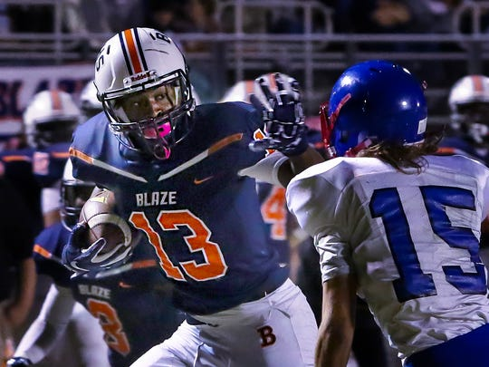 Blackman's Trey Knox looks for running room after a catch during a game against Warren County.