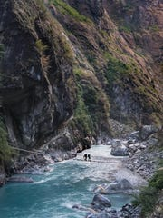 Traveling over a bridge in Nepal.