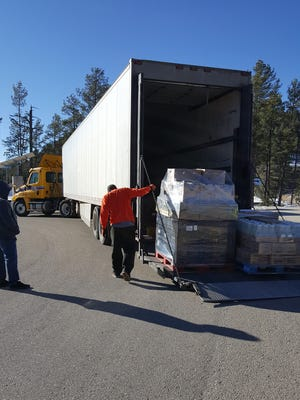 Ten pallets of food -- 5,000 pounds -- arrives for the first Ruidoso Middle School Food Pantry last Wednesday.