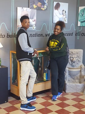 Nehemiah Rice and Taylor Braxter pose for a photo at Jackson Central-Merry High School, which will close at the end of this semester.