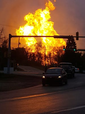 In this photo taken by Salem Township Supervisor Kerry Jobe, flames erupt during a natural gas explosion at a pipeline complex in Greensburg, Pa., Friday, April 29, 2016. The explosion, which burned one person, caused flames to shoot above nearby treetops in the largely rural Salem Township, about 30 miles east of Pittsburgh, and prompted authorities to evacuate businesses nearby. The cause of the blast wasn't immediately clear.