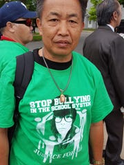 Kong Meng Yang poses for a photo during the Save Our