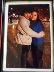 Isaiah Powell and Aqua Pedraza hug on The 400 Block ice rink in Wausau in a photo Pedraza keeps in her room.