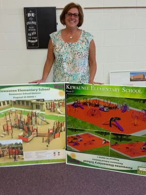 Kewaunee Superintendent Karen Treml with plans for a new all-inclusive playground. Private funds are being raised for the project.