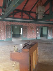 An out-of-tune piano sits in the dusty ballroom of the former Wausau Club on Sept. 9, 2016.