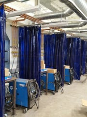 New welding booths line the walls in the Wausau West