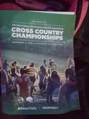 Pace High's Haley Kling (in red, center) was part of the cover photo for the program at the Florida High School Cross Country Championships in Tallahassee.