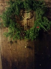 Historic buildings at Marble Springs State Historic Site are decorated with fresh greenery for the site's Christmas tours.