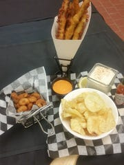 A variety of appetizers including popcorn shrimp, beer