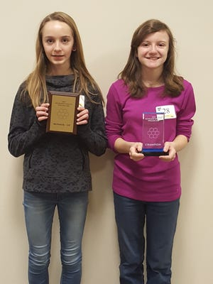 Maggie Sheridan, right, was the winner of the spelling bee. Joanna Halfhill was the runner-up. Both are students at Lexington Junior High School.
