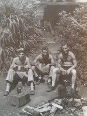 Jim Sheridan (center) served in the Marine Corps on the Pacific Island of Tinian in 1944-45