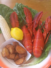 Maine lobster is served with corn and potatoes at Boondocks Fishery in Red Bank.
