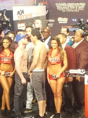 Canelo Alvarez and Julio Cesar Chavez Jr. at the weigh-in before their May 6, 2017 fight.