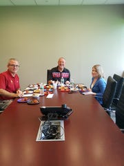 From left, David Gropper, Gary Shiman, and Lori Fox judge the contestants' meatballs.