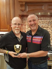 Winner of the Meatball Smackdown, John St. Clair poses with Smackdown judge,   Gary Shiman, holding the trophy.