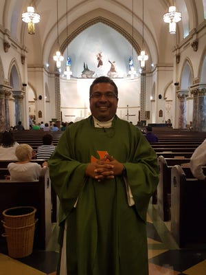 The Rev. Amilcar Benito Prado, who goes by Father Benny, is welcomed at Our Lady of Mount Carmel Church in Montclair.