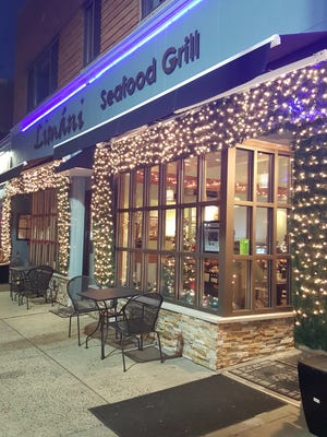The holiday-festive exterior of Limani Seafood Grill in Westfield.