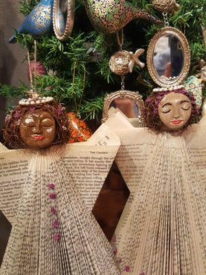 Angels created from books make interesting holiday decorations, available at the LeMoyne 54th Annual Holiday Show and Sale.